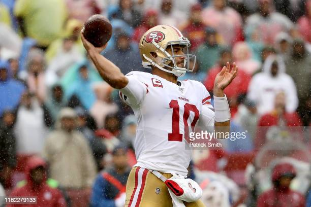 Jimmy Garoppolo of the San Francisco 49ers throws a pass against the Washington Redskins during the first quarter in the game at FedExField on...