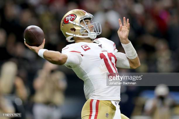 Jimmy Garoppolo of the San Francisco 49ers throws a pass against the New Orleans Saints during the second quarter in the game at Mercedes Benz...