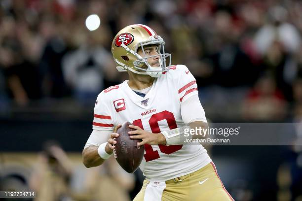 Jimmy Garoppolo of the San Francisco 49ers throws a pass against the New Orleans Saints during the first half in the game at Mercedes Benz Superdome...