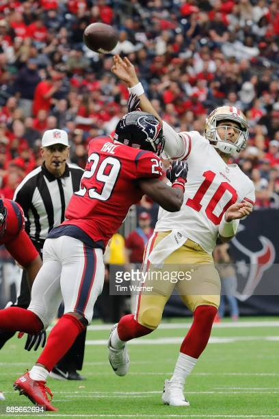 Jimmy Garoppolo of the San Francisco 49ers throws a pass pressured by Andre Hal of the Houston Texans in the third quarter at NRG Stadium on December...