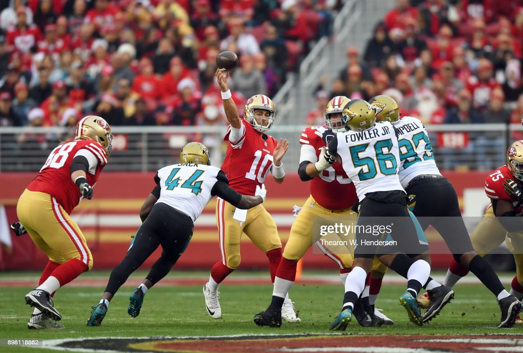 Jimmy Garoppolo #10 of the San Francisco 49ers throws a pass under pressure from Myles Jack #44 of the Jacksonville Jaguars during their NFL football game at Levi's Stadium on December 24, 2017 in Santa Clara, California.