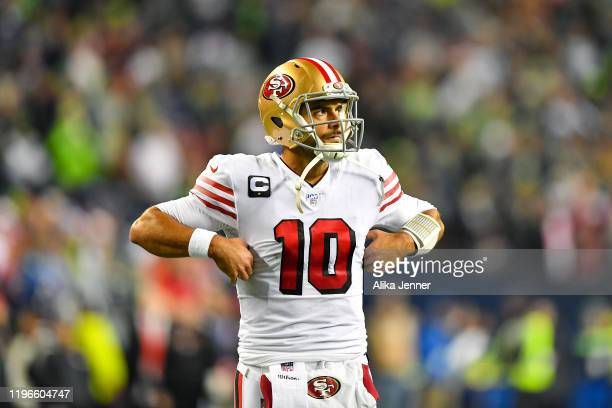 Jimmy Garoppolo of the San Francisco 49ers walks back to the huddle after a timeout during the second quarter of the game against the Seattle...