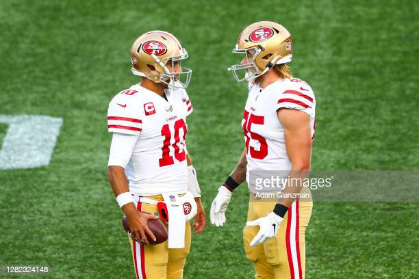 Jimmy Garoppolo talks to George Kittle of the San Francisco 49ers during a game against the New England Patriots on October 25, 2020 in Foxborough,...