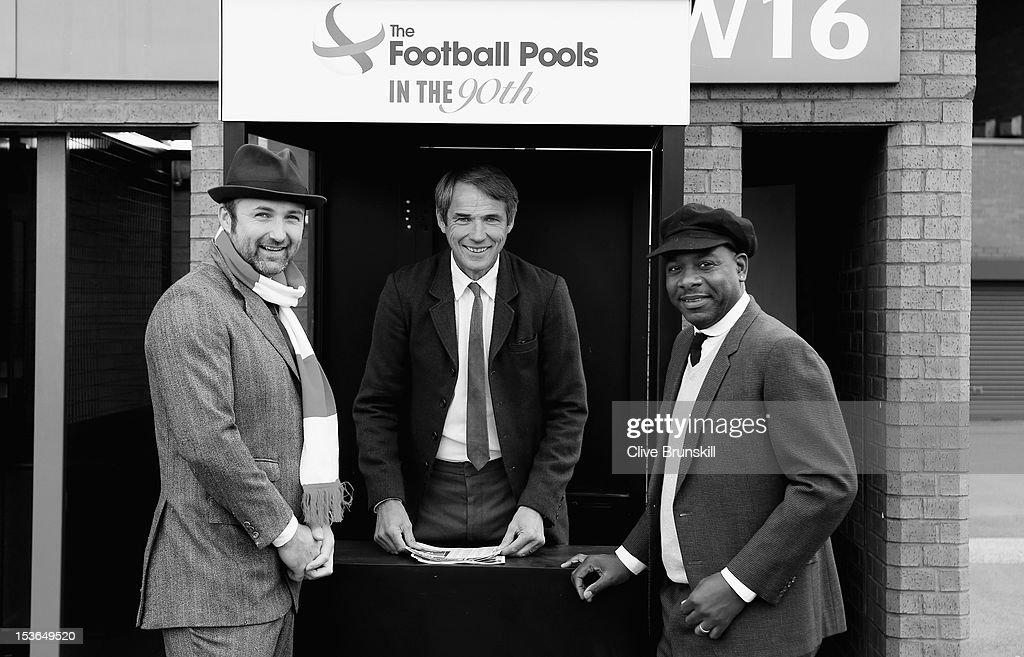 L-R Jimmy Glass, Alan Hansen and Michael Thomas pose for pictures wearing 1920's period outfits during a Football Pools photo call to launch their 90th anniversary 'In the 90th' campaign at Old Trafford on October 8, 2012 in Manchester, England. The first Football Pools coupon was sold to football fans outside Old Trafford 90 years ago.