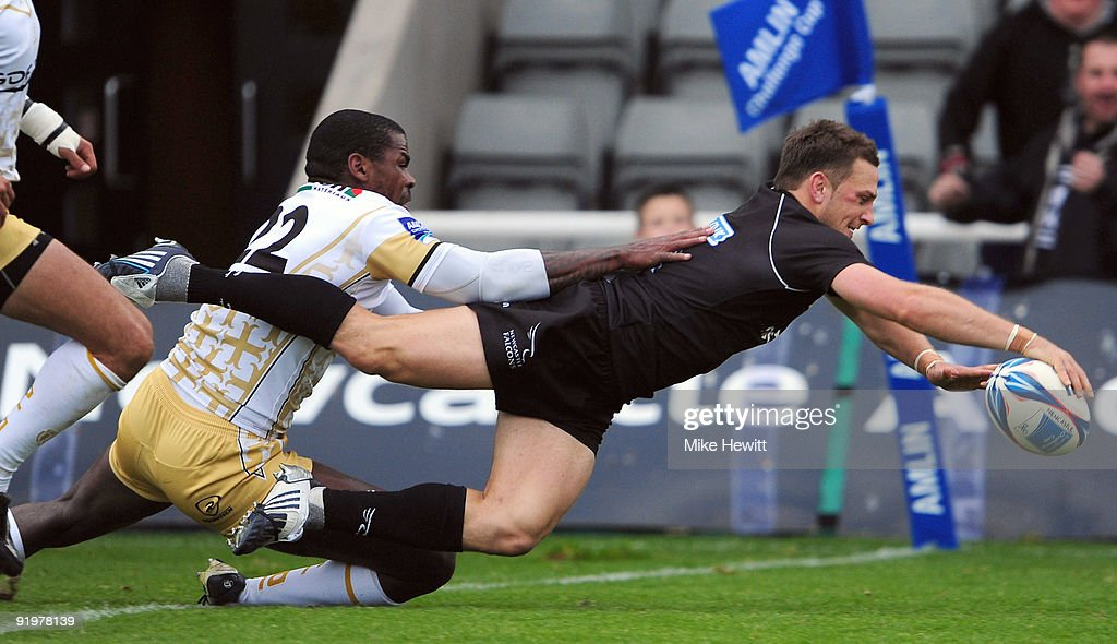 Jimmy Gopperth of Newcastle dives over to score a try during the Amlin Challenge Cup match between Newcastle Falcons and Albi at Kingston Park on October 18, 2009 in Newcastle upon Tyne, England.