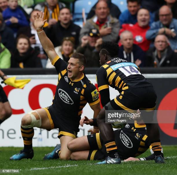 Jimmy Gopperth of Wasps celebrates as team mate Christian Wade touches down for a try during the Aviva Premiership match between Wasps and Saracens...