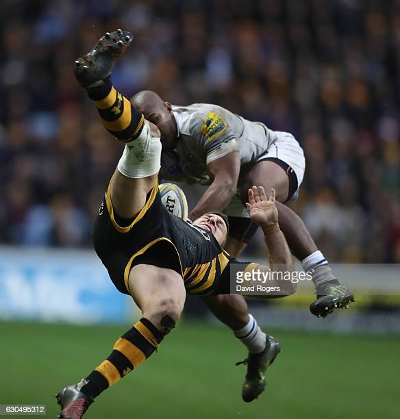 Jimmy Gopperth of Wasps falls as he is challenged by Aled Brew during the Aviva Premiership match between Wasps and Bath Rugby at The Ricoh Arena on...