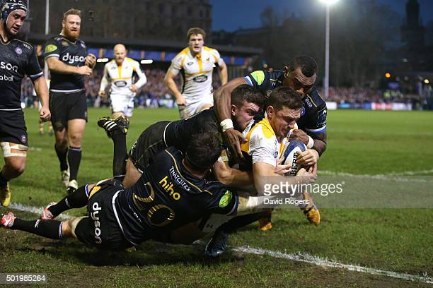 Jimmy Gopperth of Wasps holds off the Bath defence to score a try during the European Rugby Champions Cup match between Bath and Wasps at the...