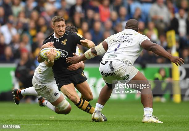 Jimmy Gopperth of Wasps is tackled by Beno Obano of Bath during the Aviva Premiership match between Wasps and Bath Rugby at The Ricoh Arena on...