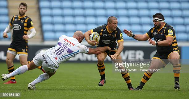 Jimmy Gopperth of Wasps is tackled by Jack Yeandle of Exeter Chiefs during the Aviva Premiership match between Wasps and Exeter Chiefs at Ricoh Arena...