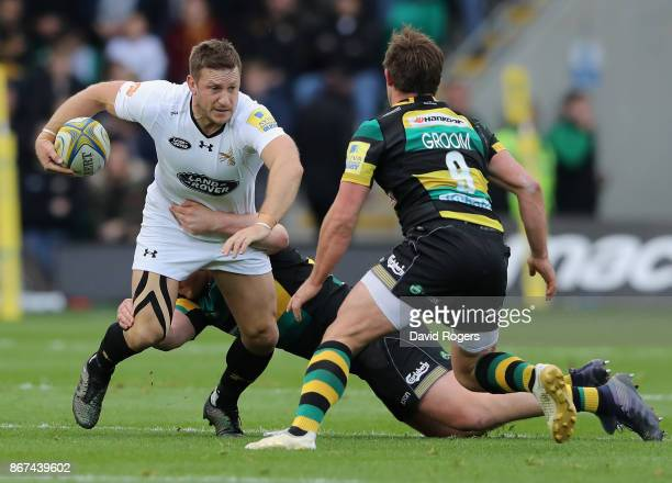Jimmy Gopperth of Wasps is tackled during the Aviva Premiership match between Northampton Saints and Wasps at Franklin's Gardens on October 28 2017...