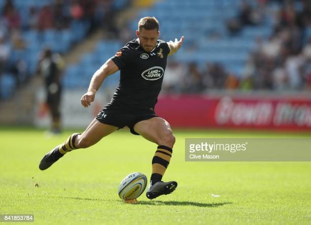 Jimmy Gopperth of Wasps kicks to convert a try during the Aviva Premiership match between Wasps and Sale Sharks at The Ricoh Arena on September 2...