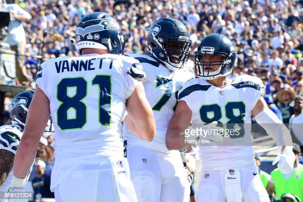 Jimmy Graham Oday Aboushi and Nick Vannett of the Seattle Seahawks celebrate after a touchdown during the game against the Los Angeles Rams at Los...