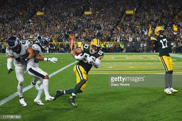 Jimmy Graham of the Green Bay Packers breaks a tackle by Andrew Sendejo and Avonte Maddox of the Philadelphia Eagles to score a touchdown during the...