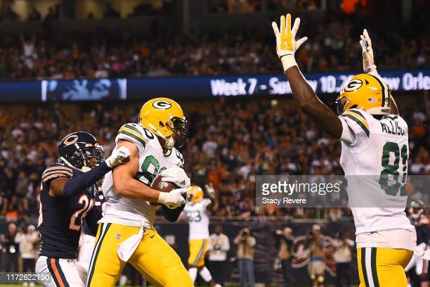 Jimmy Graham of the Green Bay Packers catches a pass for a touchdown in front of Deon Bush of the Chicago Bears during the second quarter at Soldier...