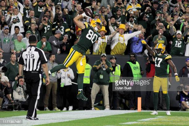 Jimmy Graham of the Green Bay Packers celebrates after scoring a touchdown in the third quarter against the Philadelphia Eagles at Lambeau Field on...
