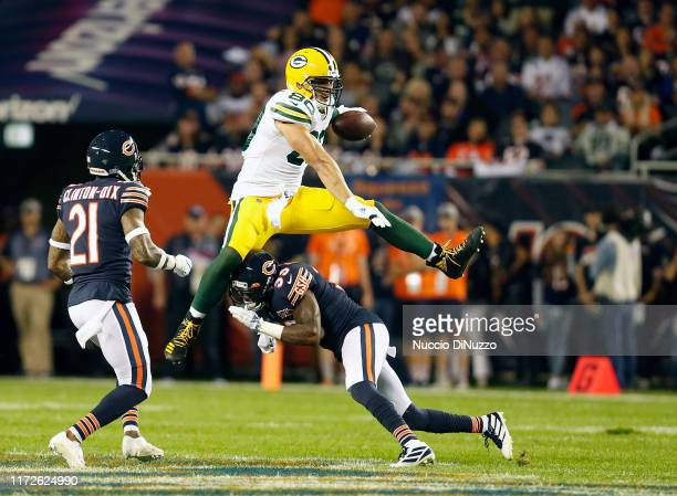 Jimmy Graham of the Green Bay Packers leaps over Eddie Jackson of the Chicago Bears during the first half at Soldier Field on September 05, 2019 in...