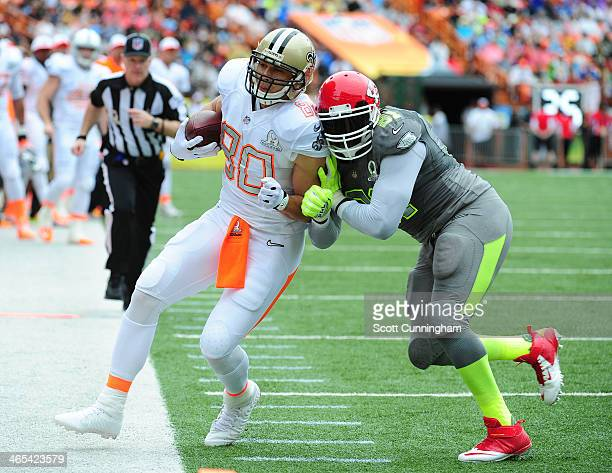 Jimmy Graham of the New Orleans Saints and Team Rice is knocked out of bounds by Tamba Hali of the Kansas City Chiefs and Team Sanders during the...
