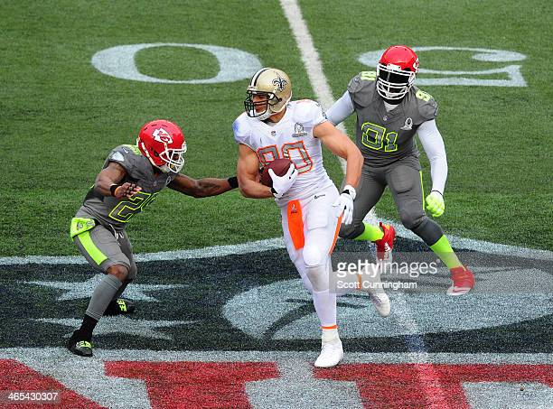 Jimmy Graham of the New Orleans Saints and Team Rice runs with a catch against Eric Berry and Tamba Hali of the Kansas City Chiefs andTeam Sanders...