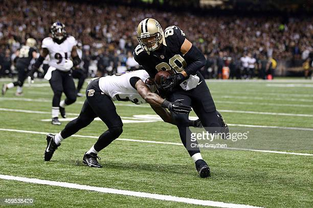 Jimmy Graham of the New Orleans Saints catches a touchdown pass in front of Will Hill of the Baltimore Ravens during the first quarter of a game at...
