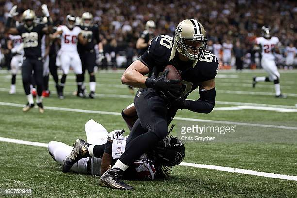Jimmy Graham of the New Orleans Saints catches a touchdown pass in front of Kemal Ishmael of the Atlanta Falcons during the fourth quarter of a game...
