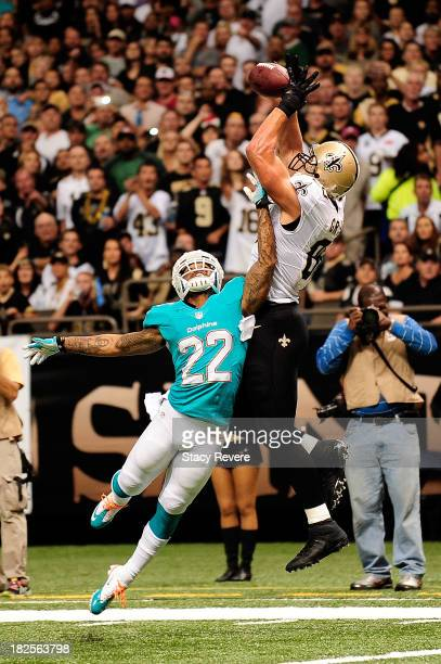 Jimmy Graham of the New Orleans Saints catches a touchdown pass over Jamar Taylor of the Miami Dolphins during a game at the MercedesBenz Superdome...