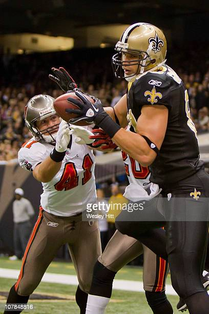 Jimmy Graham of the New Orleans Saints catches a touchdown pass against the Tampa Bay Buccaneers at the Louisiana Superdome on January 2 2011 in New...
