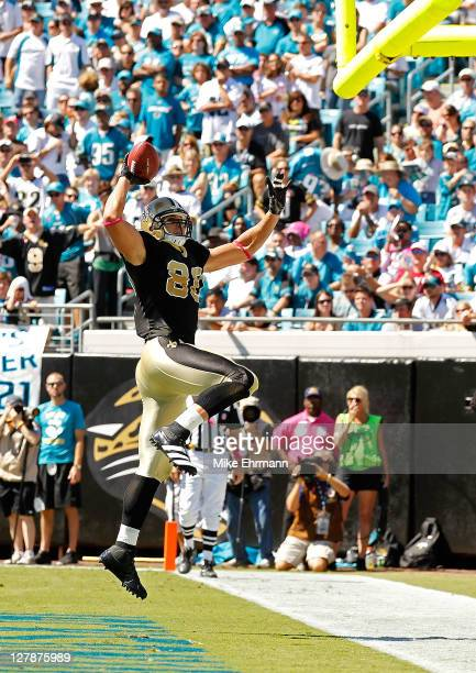Jimmy Graham of the New Orleans Saints celebrates after scoring a touchdown during a game against the Jacksonville Jaguars at EverBank Field on...