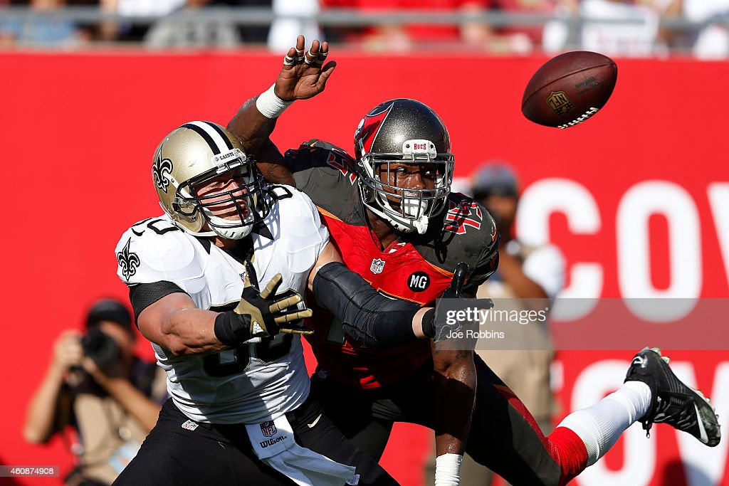 Jimmy Graham #80 of the New Orleans Saints draws a pass interference penalty in the end zone against Orie Lemon #45 of the Tampa Bay Buccaneers in the second half of the game at Raymond James Stadium on December 28, 2014 in Tampa, Florida. The Saints defeated the Bucs 23-20.