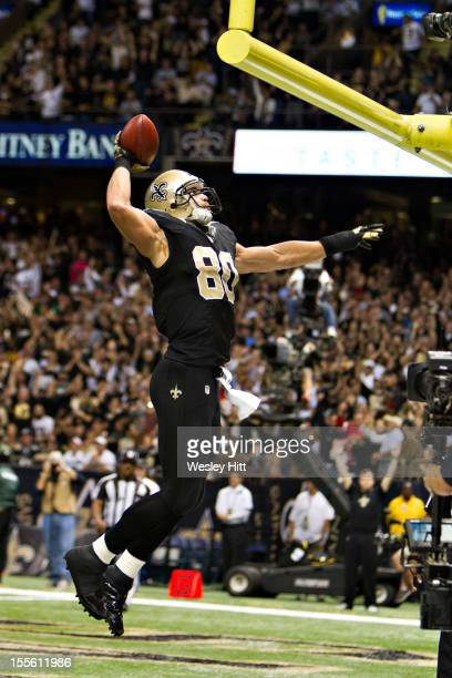 Jimmy Graham of the New Orleans Saints dunks the football after scoring a touchdown during a game against the Philadelphia Eagles at MercedesBenz...