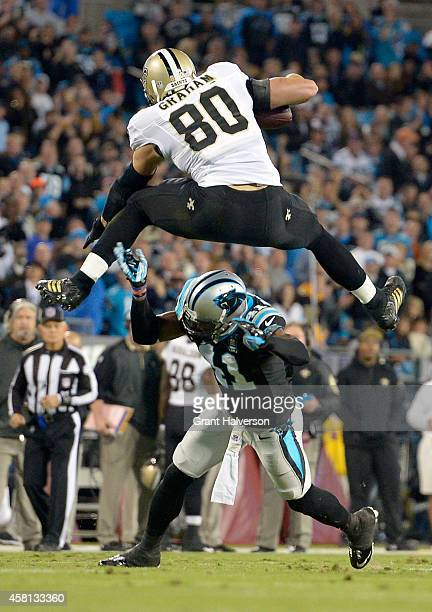 Jimmy Graham of the New Orleans Saints hurdles Roman Harper of the Carolina Panthers during their game at Bank of America Stadium on October 30 2014...