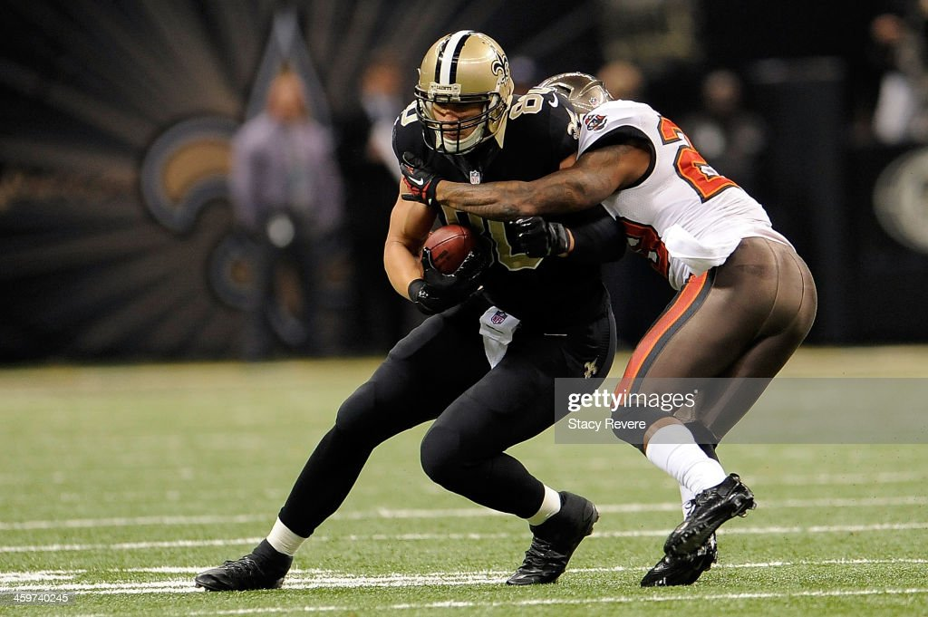 Jimmy Graham #80 of the New Orleans Saints is brought down by Leonard Johnson #29 of the Tampa Bay Buccaneers during a game at the Mercedes-Benz Superdome on December 29, 2013 in New Orleans, Louisiana. New Orleans won the game 42-17.