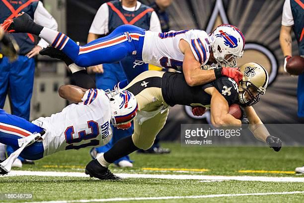 Jimmy Graham of the New Orleans Saints is tackled by Jairus Byrd and Kiko Alonso of the Buffalo Bills at Mercedes-Benz Superdome on October 27, 2013...