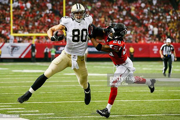 Jimmy Graham of the New Orleans Saints is tackleds by Dwight Lowery of the Atlanta Falcons in the first half against the New Orleans Saints at the...