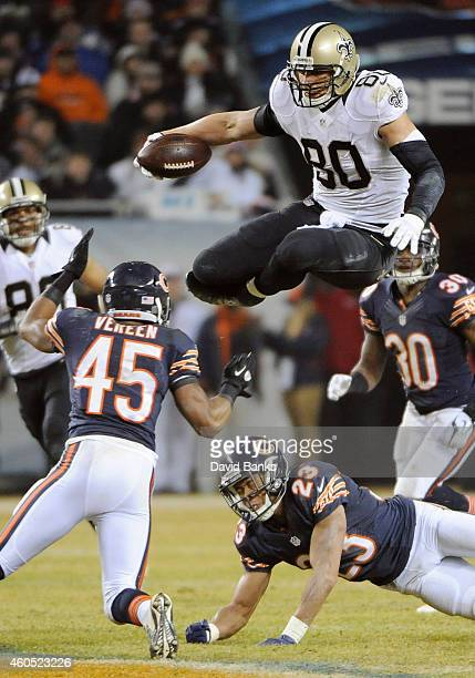 Jimmy Graham of the New Orleans Saints jumps over Kyle Fuller of the Chicago Bears and Brock Vereen of the Chicago Bears during the fourth quarter at...