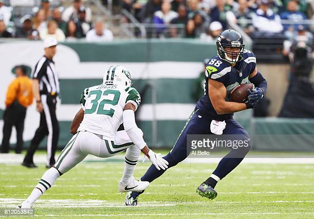 Jimmy Graham of the Seattle Seahawks carries the ball against Juston Burris of the New York Jets in the fourth quarter at MetLife Stadium on October...