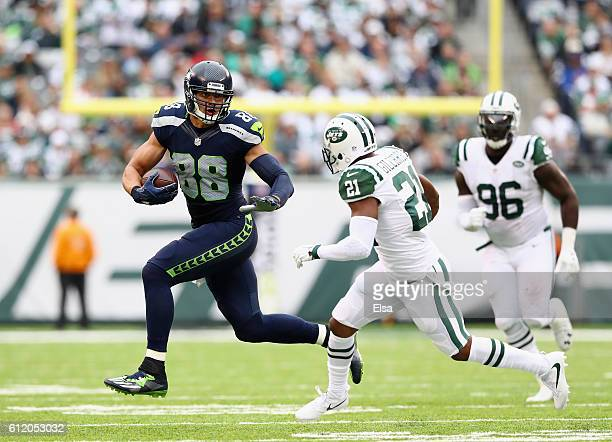 Jimmy Graham of the Seattle Seahawks carries the ball against Marcus Gilchrist of the New York Jets in the second half at MetLife Stadium on October...