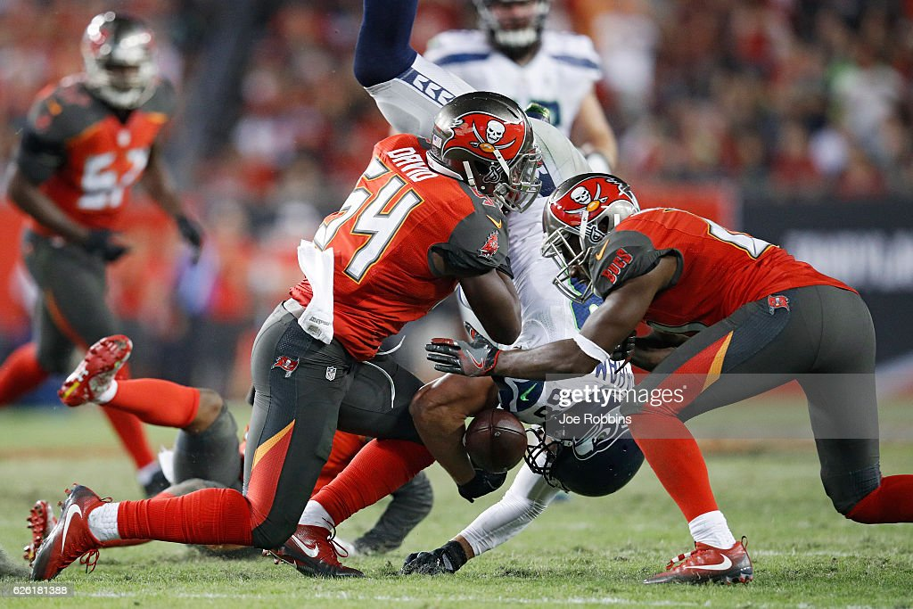Jimmy Graham #88 of the Seattle Seahawks fumbles the ball after being hit by Lavonte David #54 of the Tampa Bay Buccaneers in the fourth quarter of the game at Raymond James Stadium on November 27, 2016 in Tampa, Florida. The Buccaneers defeated the Seahawks 14-5.