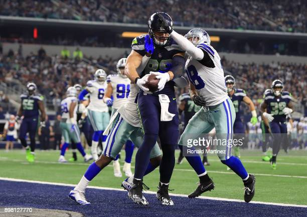 Jimmy Graham of the Seattle Seahawks pulls in a touchdown against Jourdan Lewis of the Dallas Cowboys and Jeff Heath of the Dallas Cowboys at ATT...