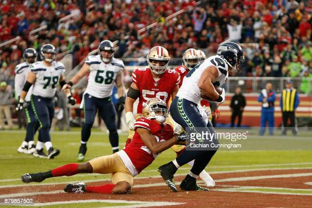 Jimmy Graham of the Seattle Seahawks scores a touchdown against Ahkello Witherspoon of the San Francisco 49ers at Levi's Stadium on November 26 2017...