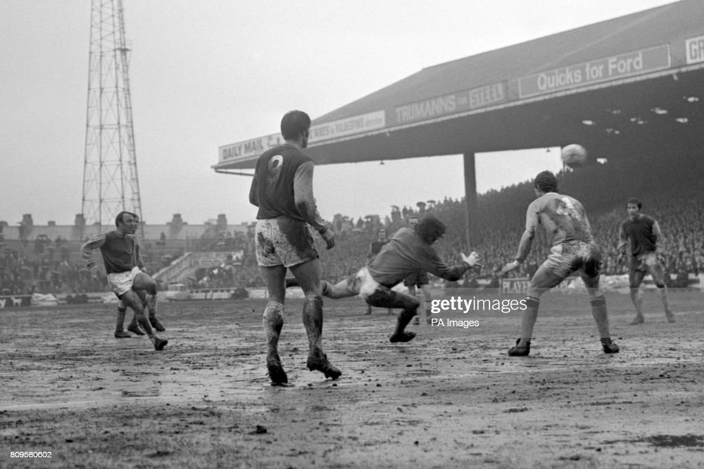 Jimmy Greaves (l), making his debut for West Ham United, scores his second goal of the game past Manchester City goalkeeper Joe Corrigan. West Ham United went on to win the game 5-1.