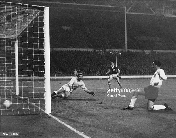 Jimmy Greaves of England scores past Northern Ireland goalkeeper Harry Gregg in a British Championship match at Wembley Stadium London 20th November...