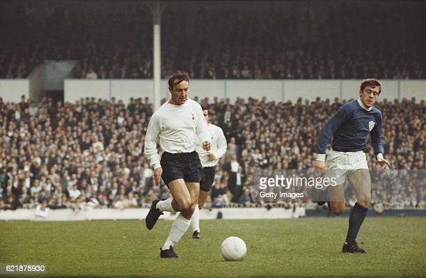 Jimmy Greaves of Spurs outpaces David Nish of Leicester City during a First Division match between Totenham Hotspur and Leicester City at White Hart...