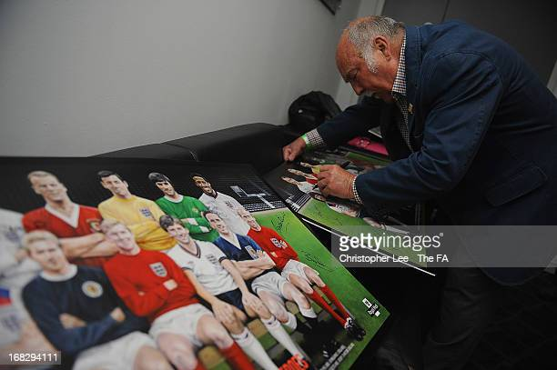 Jimmy Greaves signs copies of the team group stamp during the Royal Mail Stamp Launch at Wembley Stadium on May 8, 2013 in London, England.