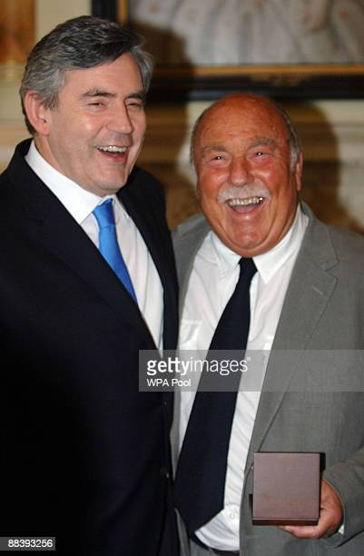 Jimmy Greaves smiles after collecting his medal presented by Prime Minister Gordon Brown for representing his country in the 1966 World Cup at...