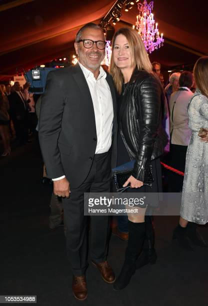 Jimmy Hartwig and his wife Stefanie Almer during the VIP premiere of Schuhbecks Teatro at Spiegelzelt on October 25, 2018 in Munich, Germany.