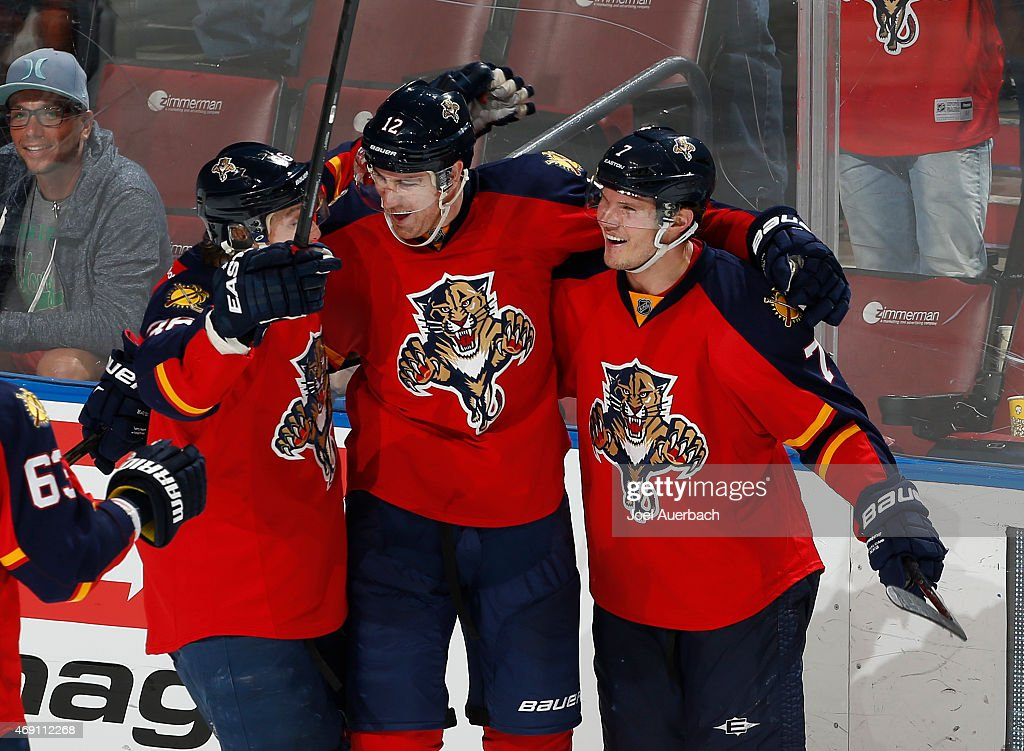 Jimmy Hayes #12 is congratulated by Dmitry Kulikov #7 and Jaromir Jagr #68 of the Florida Panthers after he scored the final goal of the game against the Boston Bruins at the BB&T Center on April 9, 2015 in Sunrise, Florida. The Panthers defeated the Bruins 4-2.