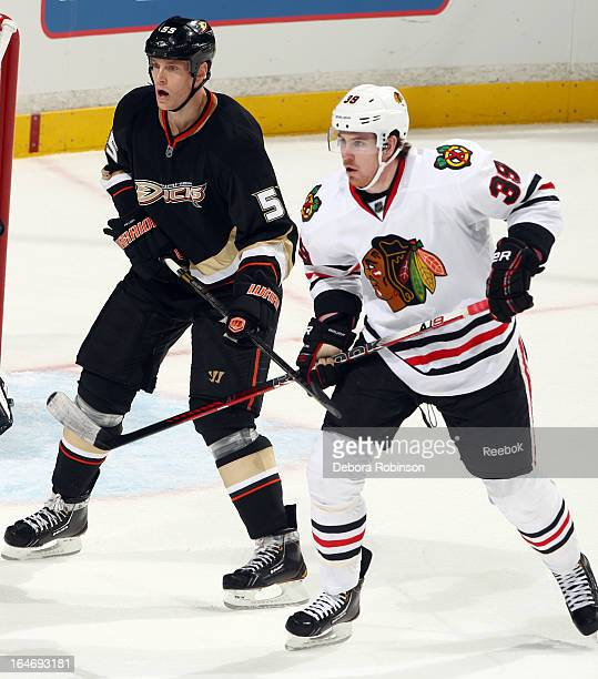 Jimmy Hayes of the Chicago Blackhawks battles for position against Bryan Allen of the Anaheim Ducks on March 20 2013 at Honda Center in Anaheim...