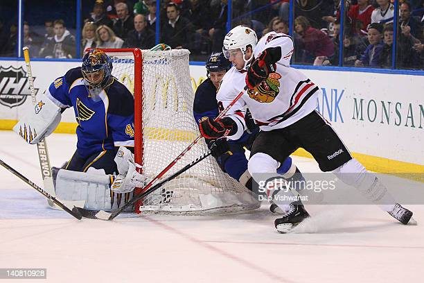Jimmy Hayes of the Chicago Blackhawks takes a shot on goal against Jaroslav Halak and Kevin Shattenkirk both of the St Louis Blues at the Scottrade...