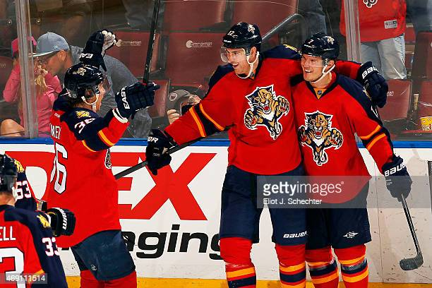 Jimmy Hayes of the Florida Panthers celebrates his goal with teammates Jussi Jokinen and Dmitry Kulikov against the Boston Bruins at the BBT Center...